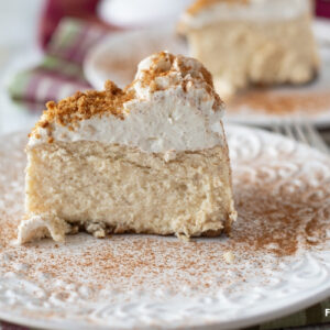 A slice of Instant Pot Eggnog Cheesecake on a dessert plate