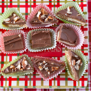 Saltine Cracker Toffee recipe in candy papers on a red, green and gold holiday serving plate.