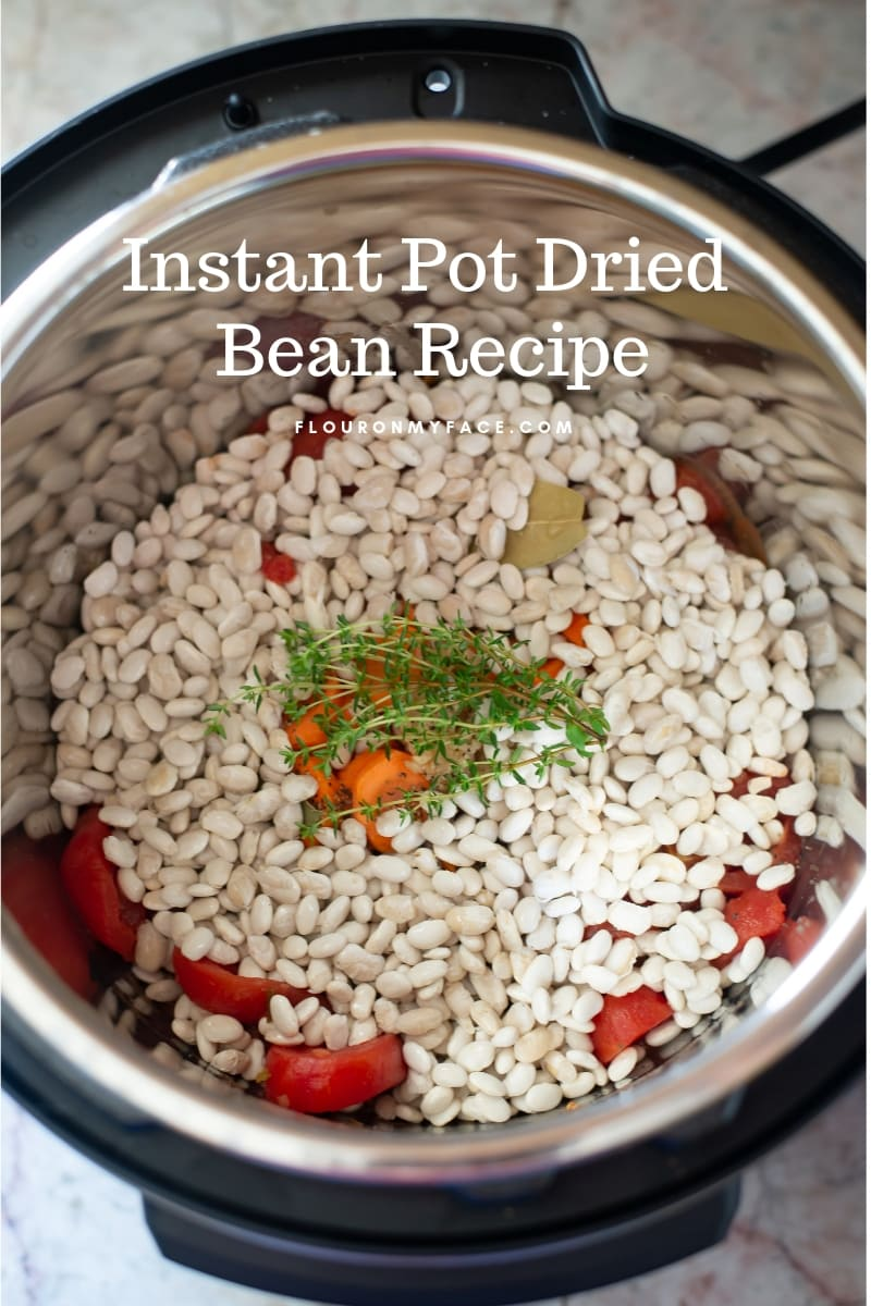 Instant Pot filled with the ingredients to make Instant Pot Ham and White Bean Soup recipe