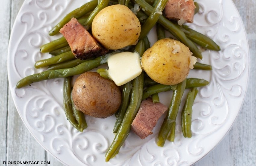 A serving of Instant Pot Green Beans cooked with ham on a plate.