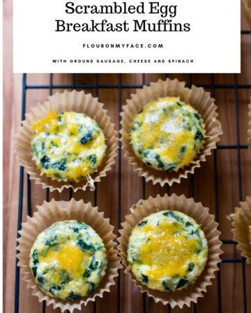 Freshly baked scrambled egg breakfast muffins cooling on a baking rack.