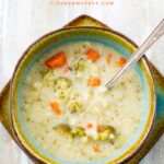 Creamy Instant Pot Cauliflower Broccoli Soup recipe served in a teal and brown soup bowl