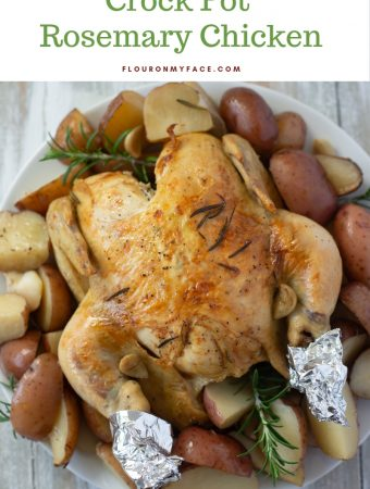 Crock Pot Rosemary Chicken recipe served on a white glass platter with baby red potatoes.