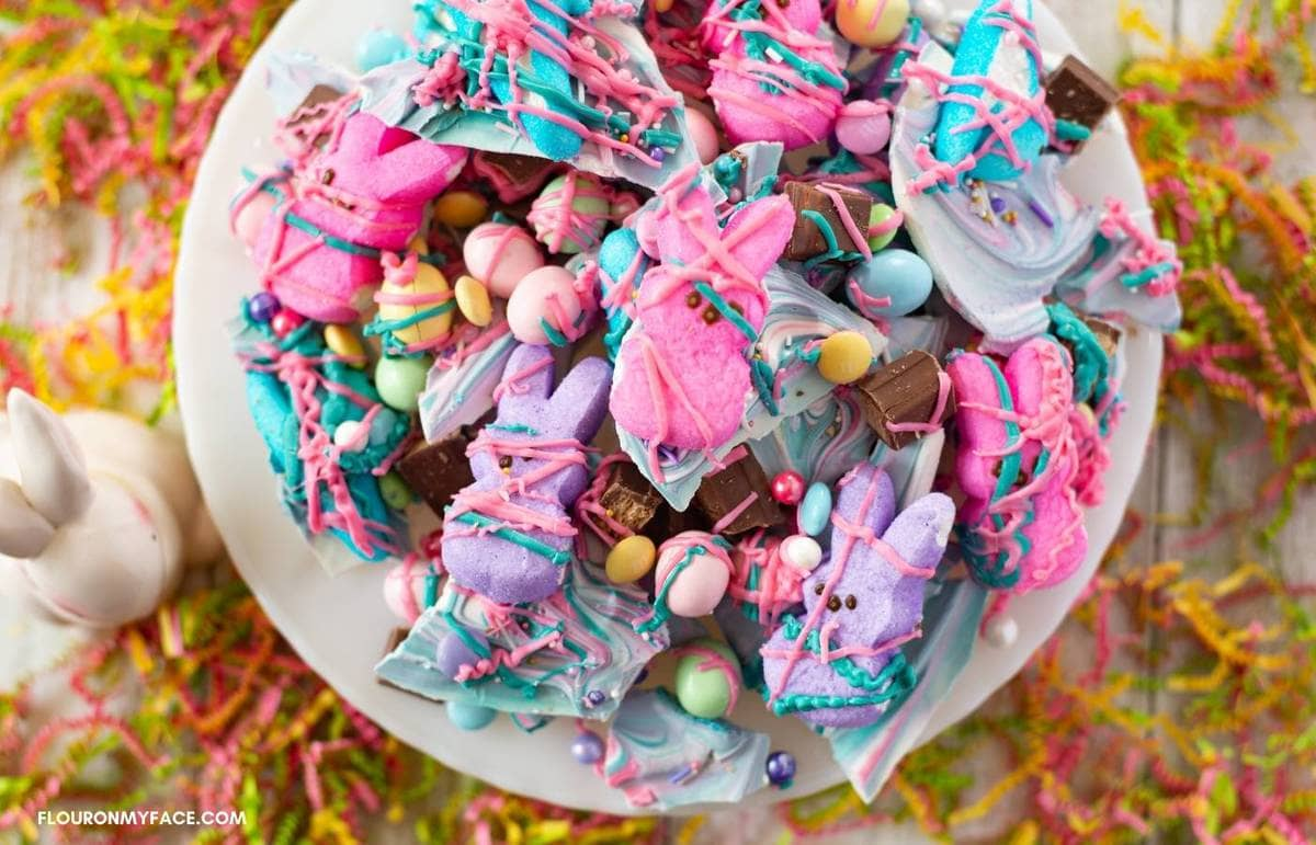 Easter Candy Bark piled on a white cake plate.