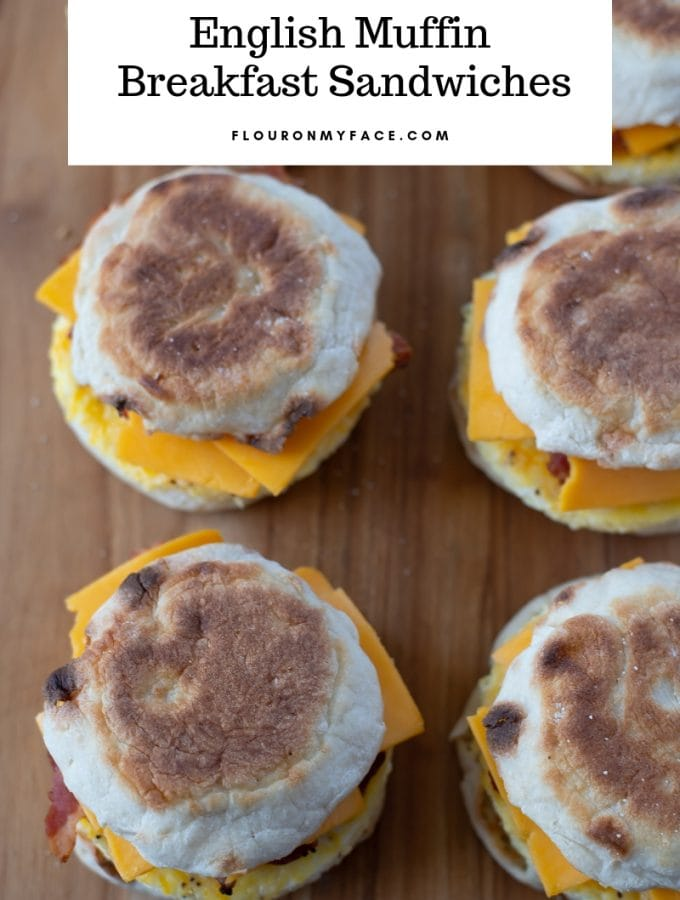 English Muffin Breakfast sandwiches on a wooden cutting board