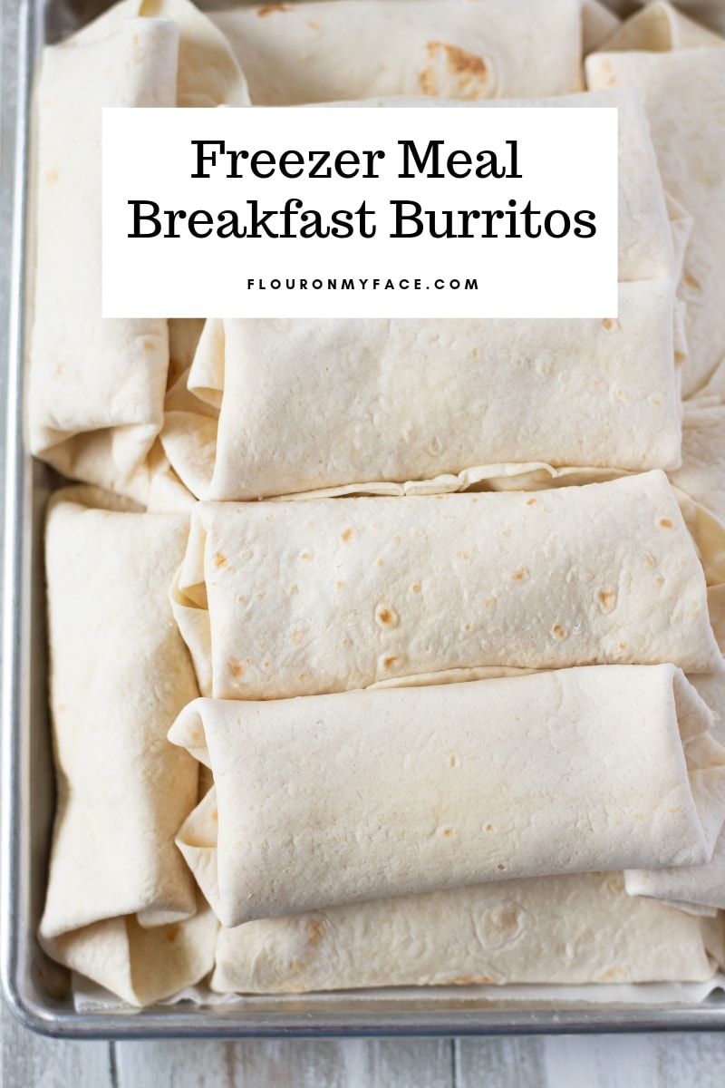 A baking tray filled with Freezer Mexican Breakfast Burritos
