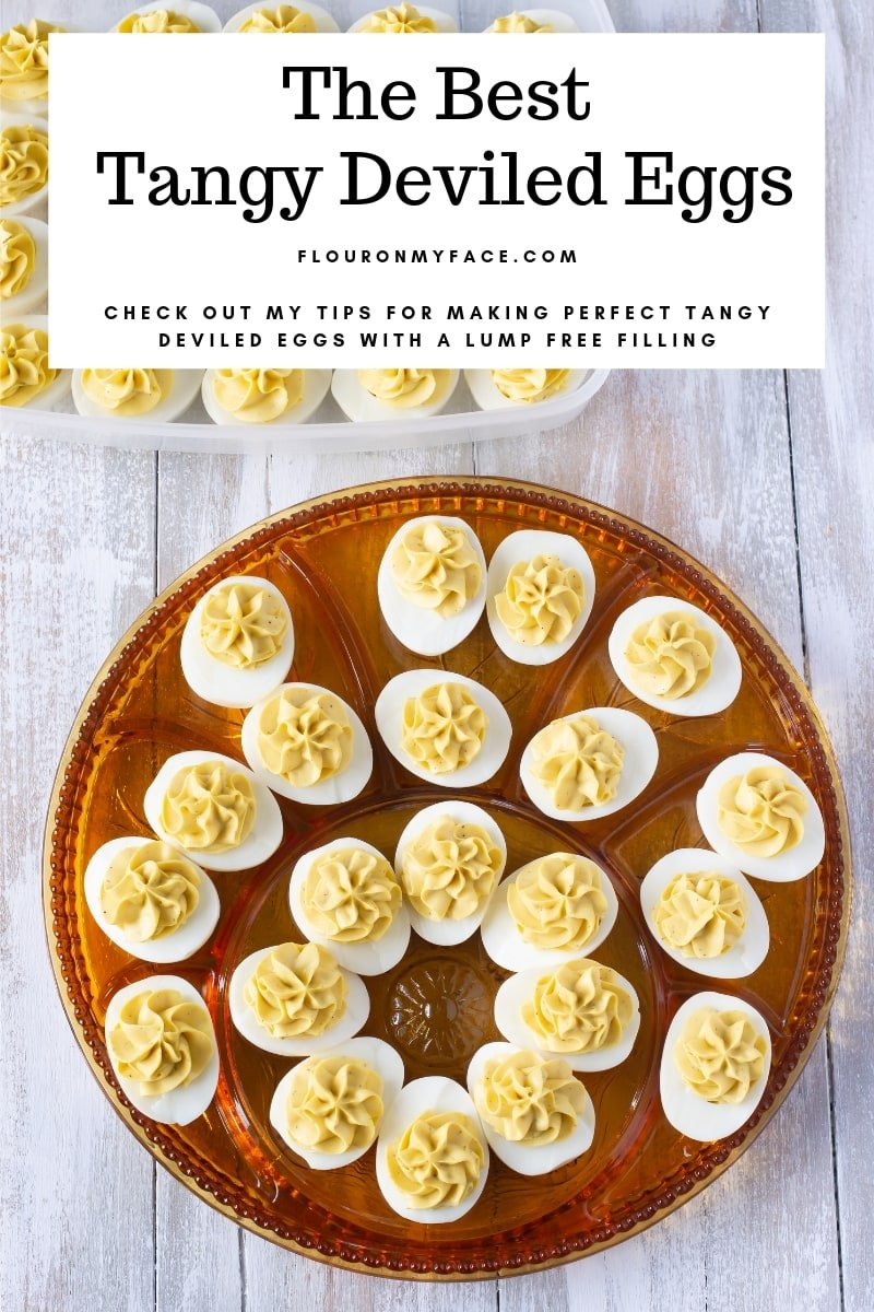 Holiday glass plate filled with Tangy Deviled Eggs