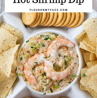 Crock Pot Hot Shrimp Dip recipe served in a sip plate with chips and crackers