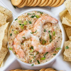 Picture pf Crpck Pot Hot Shrimp Dip that is in a chip and dip serving platter