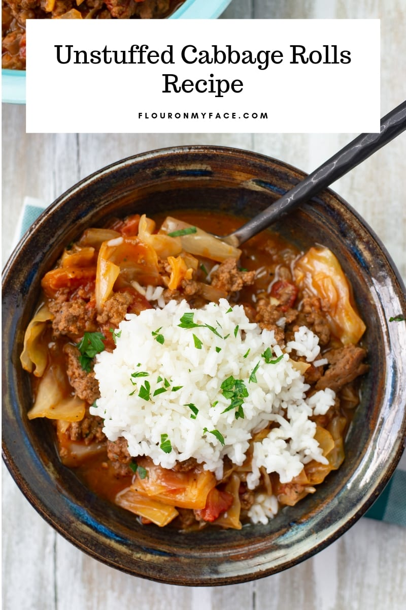 A serving bowl fill with Crock Pot Unstuffed Cabbage Rolls with a scoop of white rice in the center.