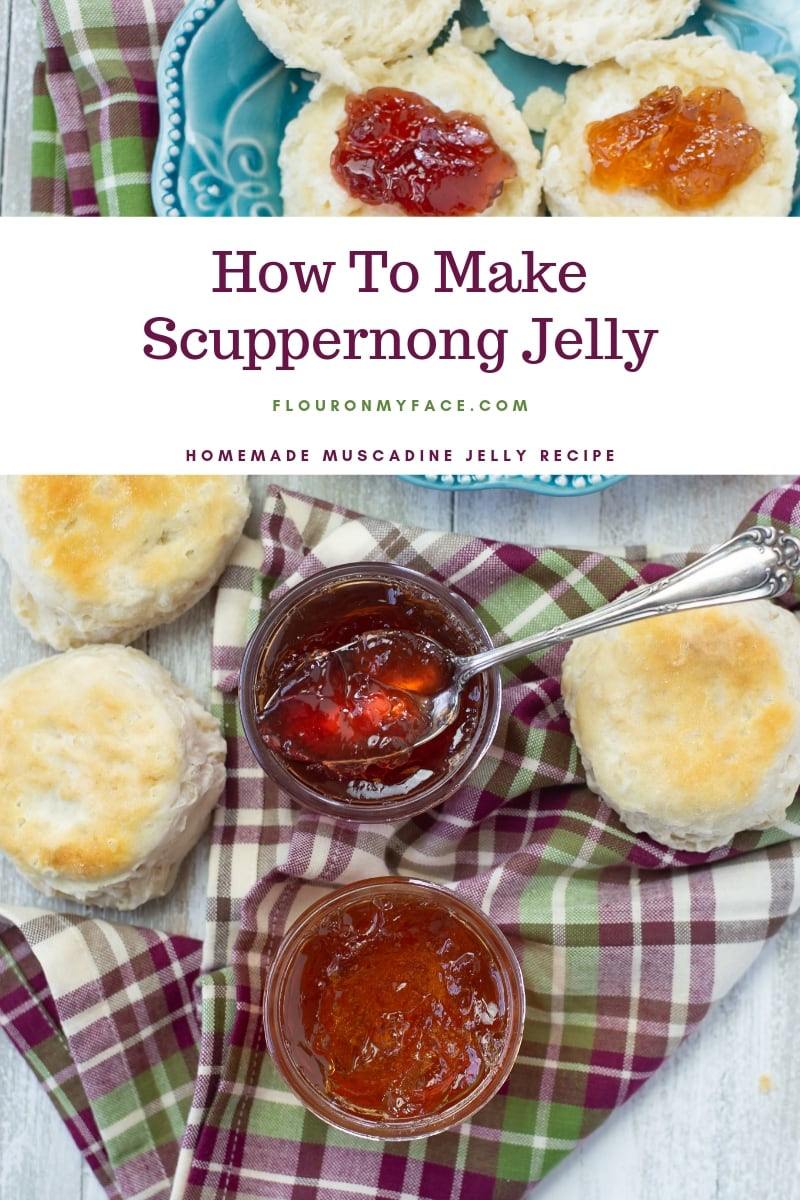 Two jars of homemade scuppernong jelly with freshly baked biscuits on a cloth napkin.
