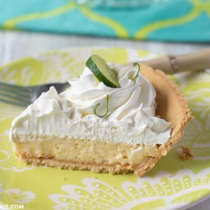 A photo of a sliced piece of Authentic Key Lime Pie on a plate.