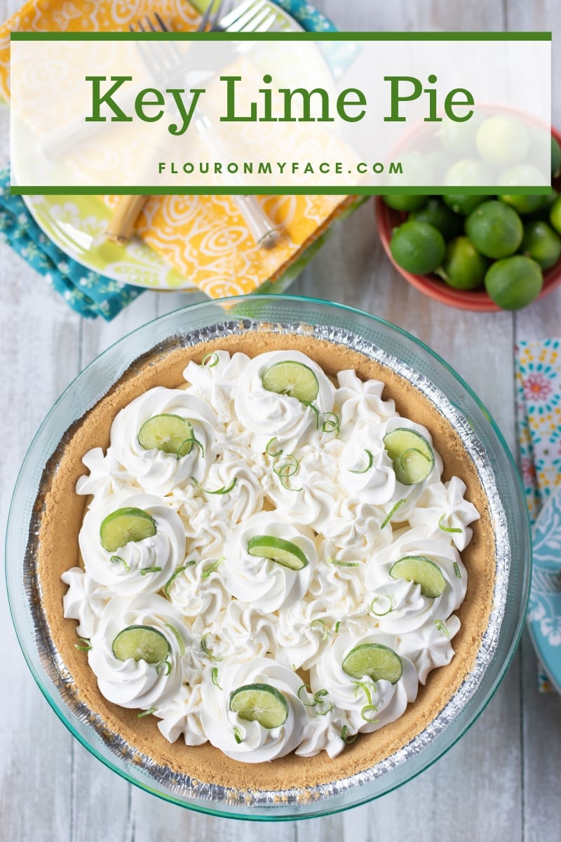 Key Lime Pie topped with whipped cream and garnished with Key lime slices