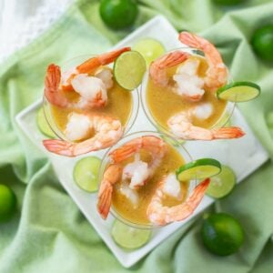 3 mini appetizer cups filled with shrimp in a Key Lime Mustard Sauce.