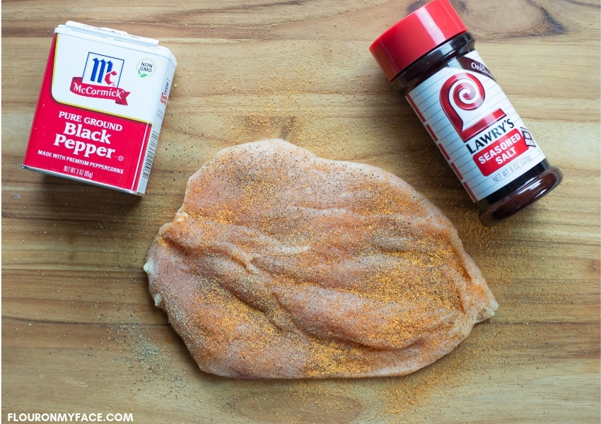 a butterflied, boneless skinless chicken breast that has been seasoned with black pepper and seasoned salt
