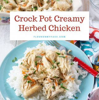 A light blue plate with a serving of Crock Pot Creamy Herbed Chicken on a bed of rice.