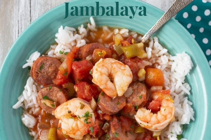 a teal bowl filled with Crock Pot Shrimp and Sausage Jambalaya served over white rice.