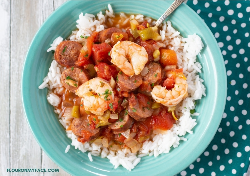 Slow cooker Jambalaya recipe served over white rice in a bowl