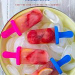 Homemade Strawberry Lemonade Ice Pops on a bed of ice cubes to keep this kid friendly frozen treat chilled