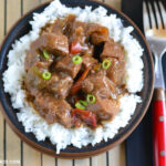serving homemade pepper steak over white rice for dinner.