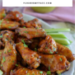 a serving platter full of Honey BBQ Chicken Wings to serve as a party appetizer or for games day.