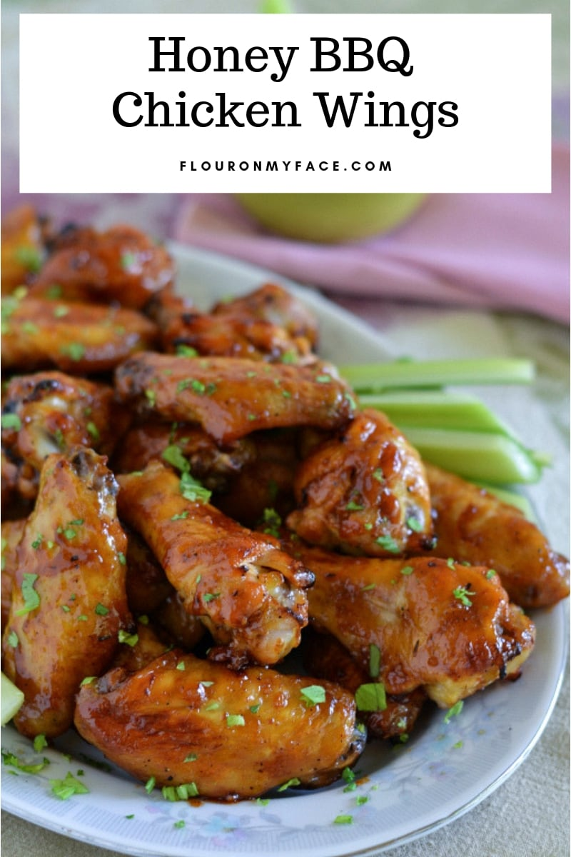a serving platter full of Honey BBQ Chicken Wings to serve as a party appetizer.