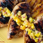 Key Lime Grilled Chicken breasts served with fresh mango salsa and grilled pineapple slices