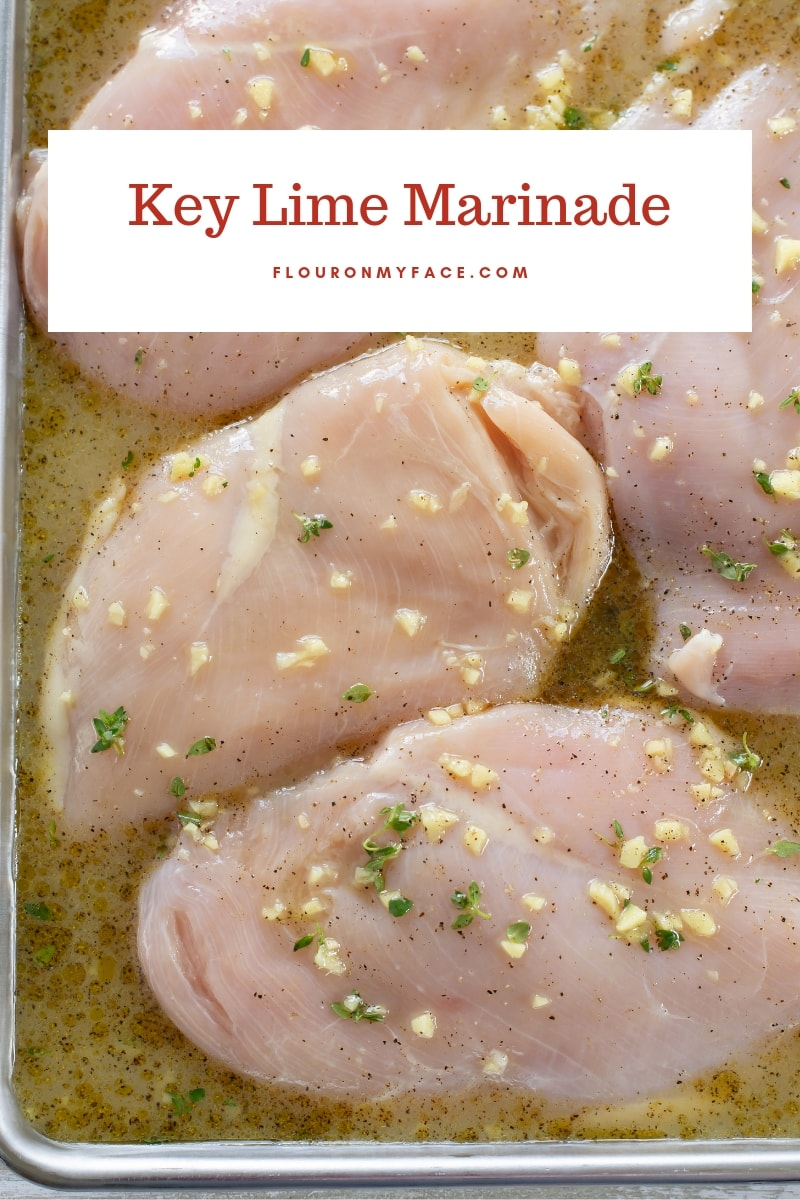 Boneless chicken breasts marinading in a baking pan, covered in Key Lime Marinade