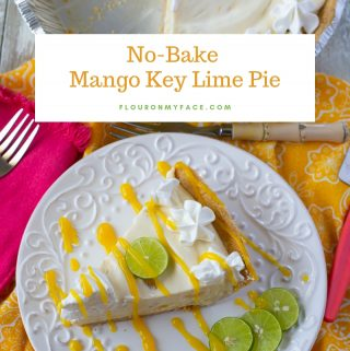 A slice of pie on a dessert plate wth drizzled mando sauce and key lime slices for garnish