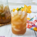 A close up photo of a glass full of freshly made Carambola Iced Tea Cooler