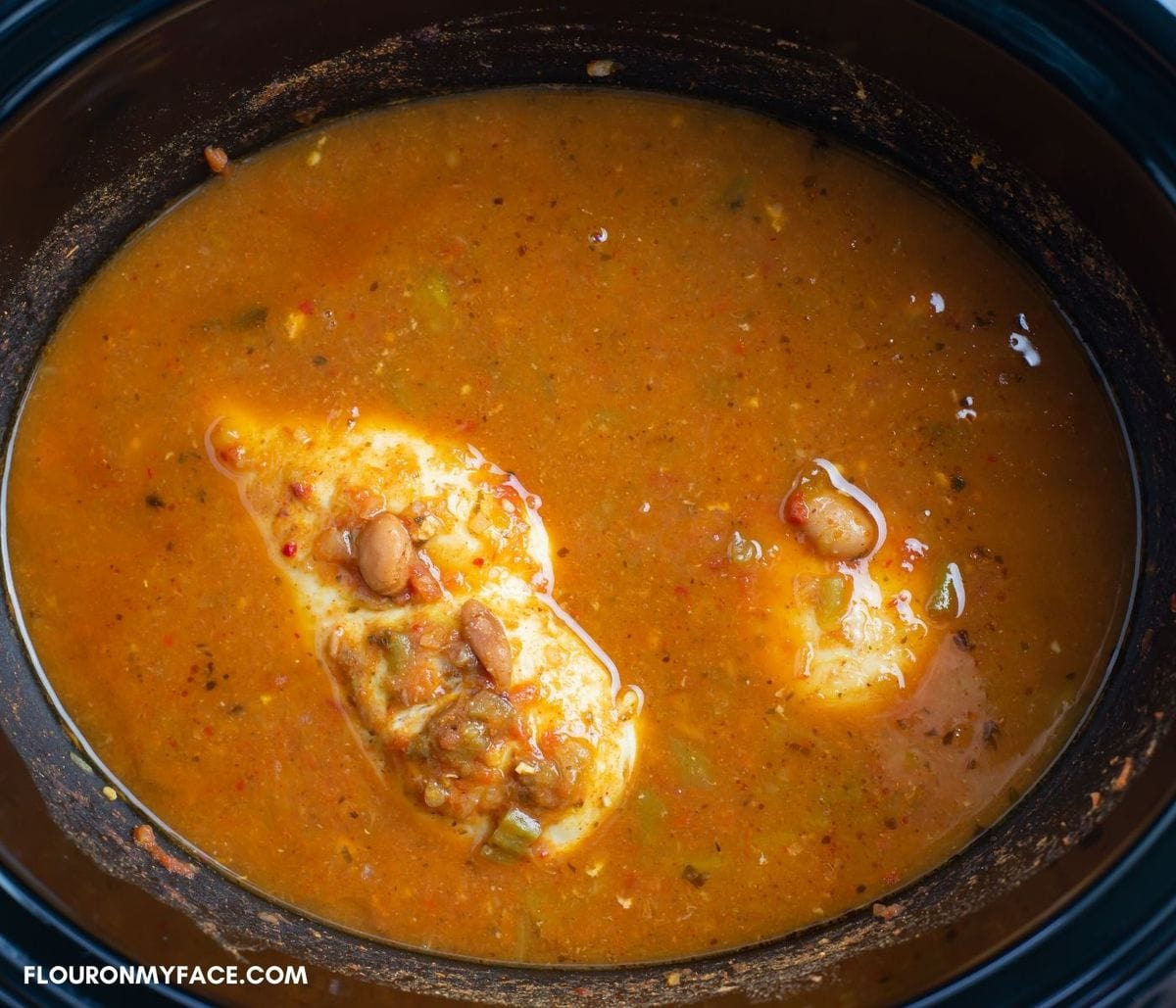 Boneless chicken that has slow cooked with sauce and beans.