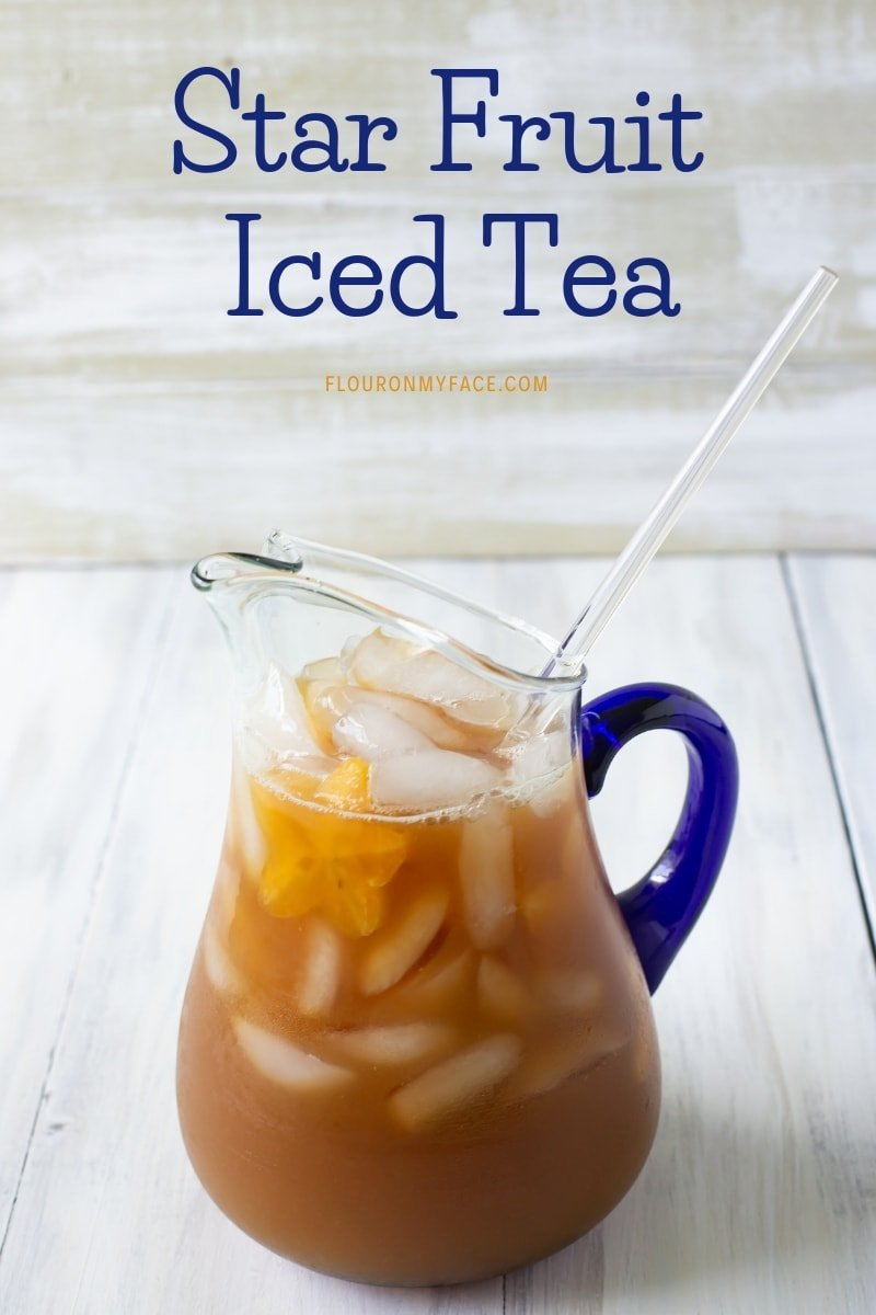 a glass pitcher full of Star Fruit Iced Tea