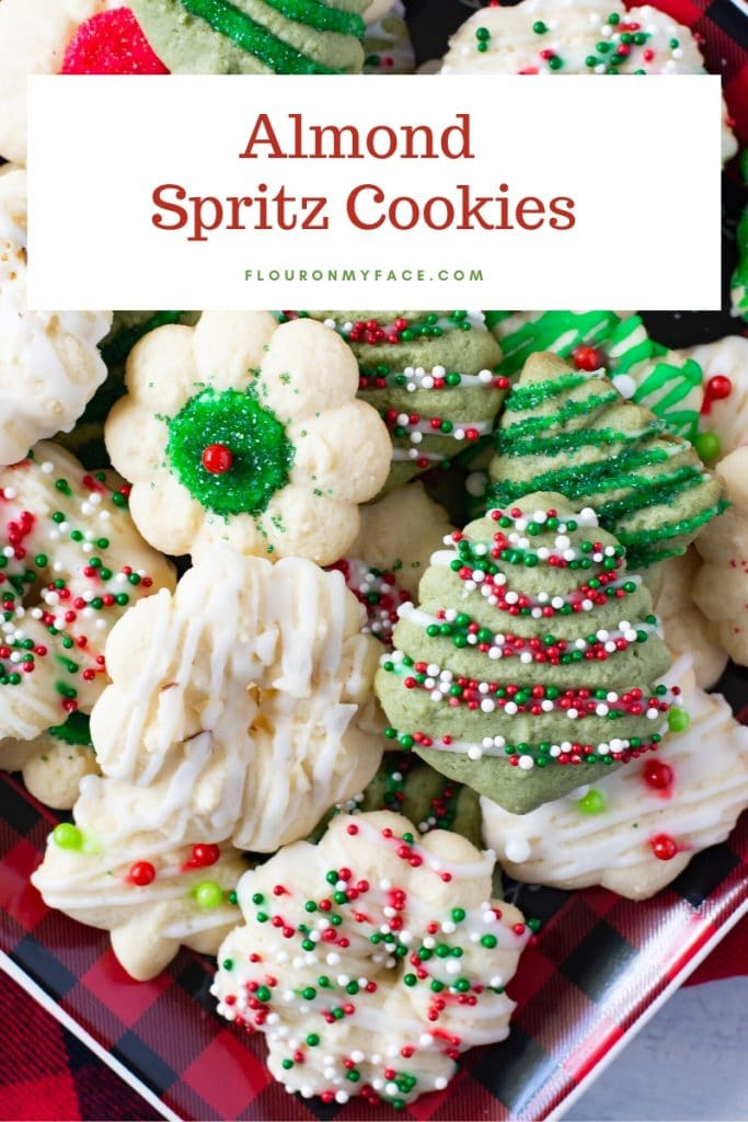 A holiday plate with a variety of examples of how you can decorate Almond Spritz Cookies