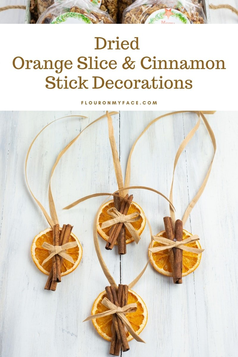 Dried Orange Slices and Cinnamon Stick Decorations with a raffia bow and raffia ribbon ties to hang on holiday gifts.