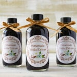 Closeup of 3 bottles of homemade vanilla extract