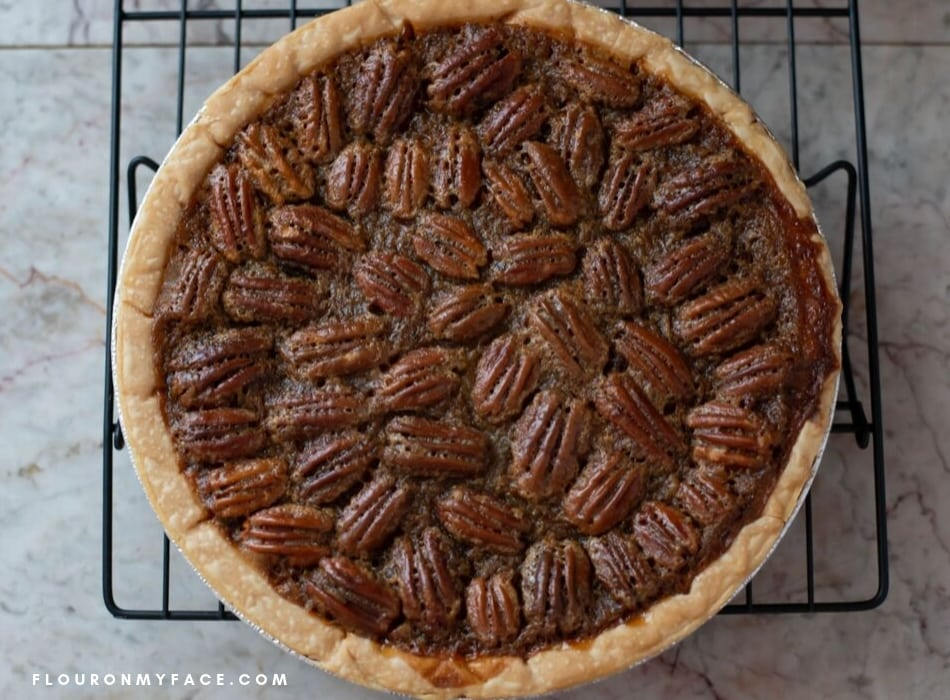 a freshly baked Pecan Pie recipe as it cools on a cooling rack.