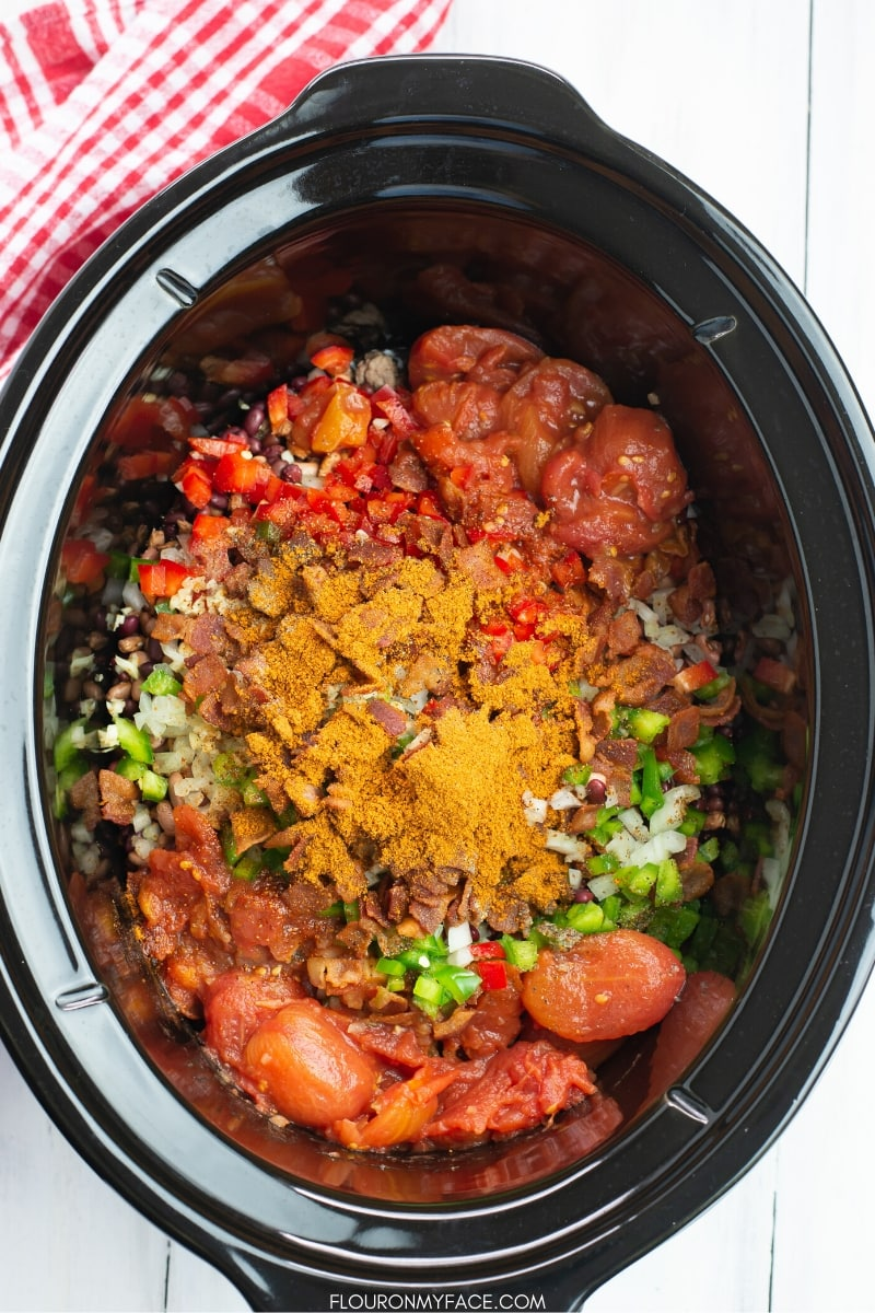 Crock Pot filled with the ingredients to make Cowboy Bean Soup