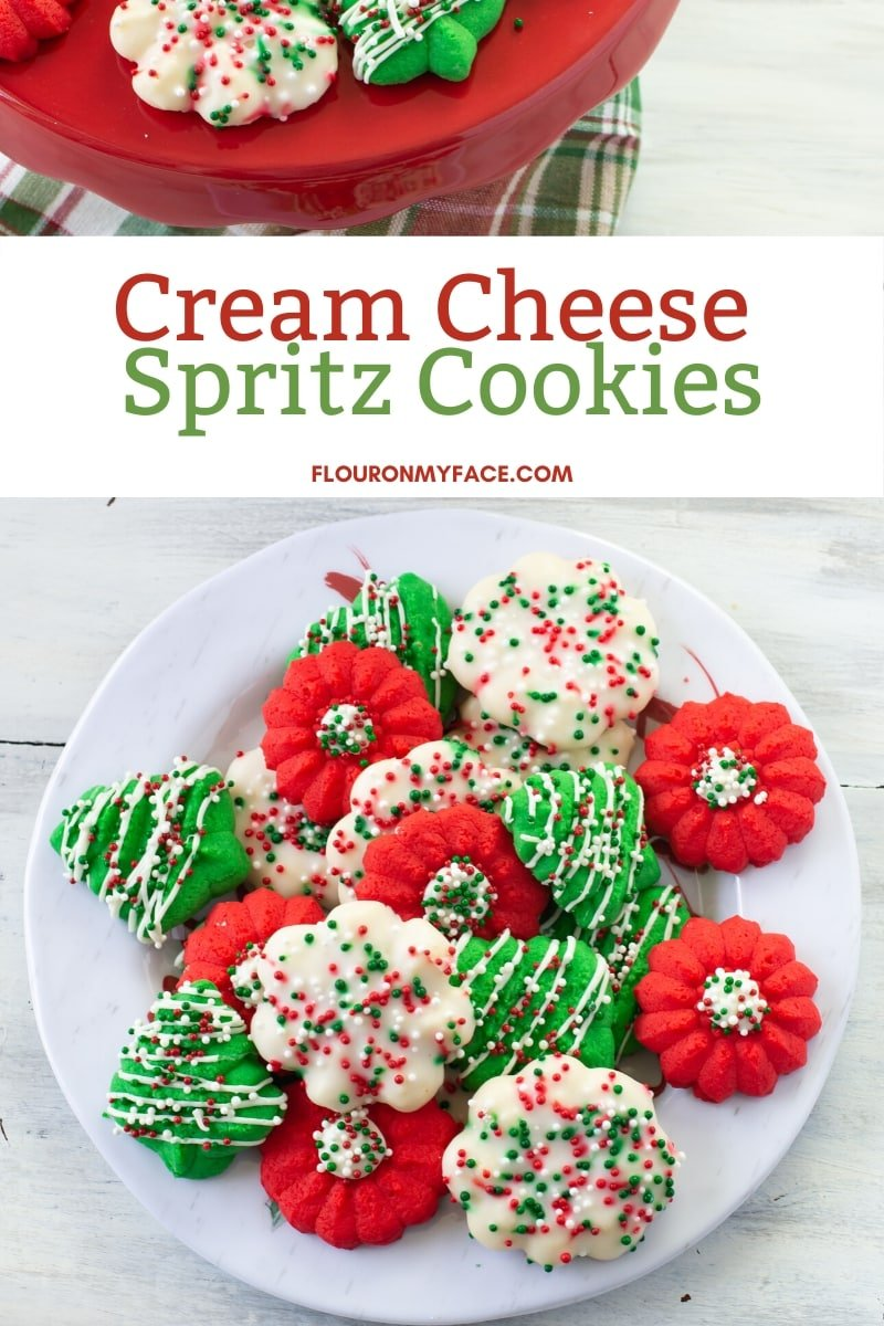 A holiday plate piled high with decorated Cream Cheese Spritz Cookies
