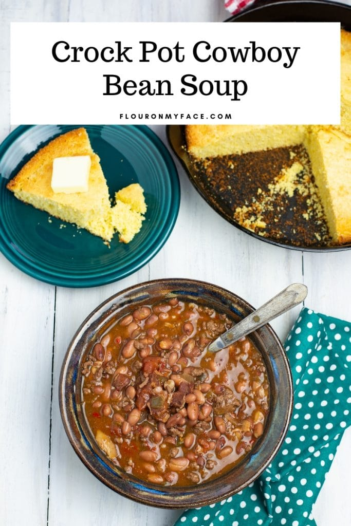 A bowl of Crock Pot Cowboy Bean Soup served with skillet corn bread
