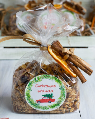 Homemade Christmas Granola recipe packaged in a cellophane bag.