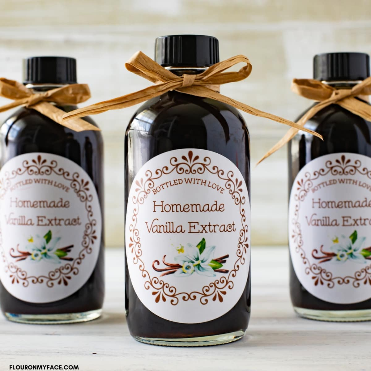 Bottled homemade vanilla extract with free printable labels