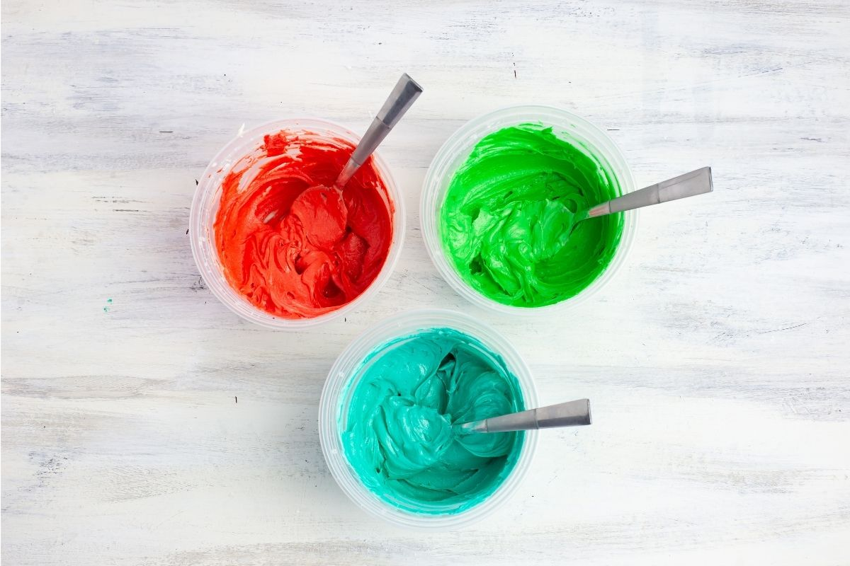 3 bowls filled with colored cookie filling.