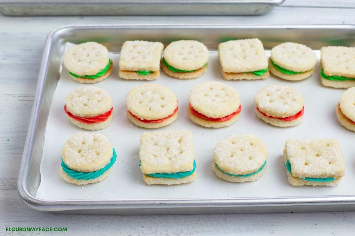 filled sandwich cookies on a baking sheet.