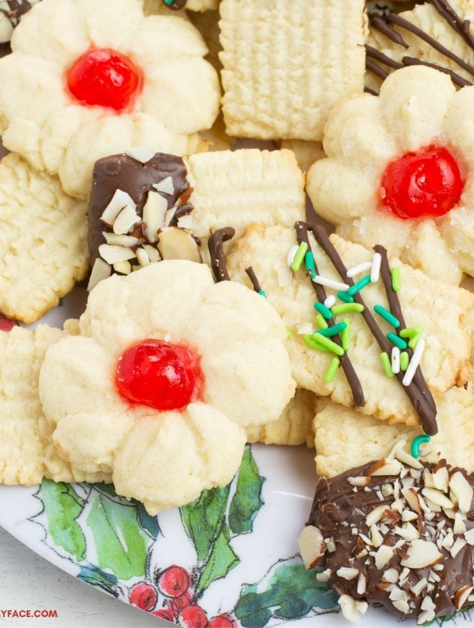 A holiday plate with a variety of German Christmas cookies made with a German Spritz Cookies recipe