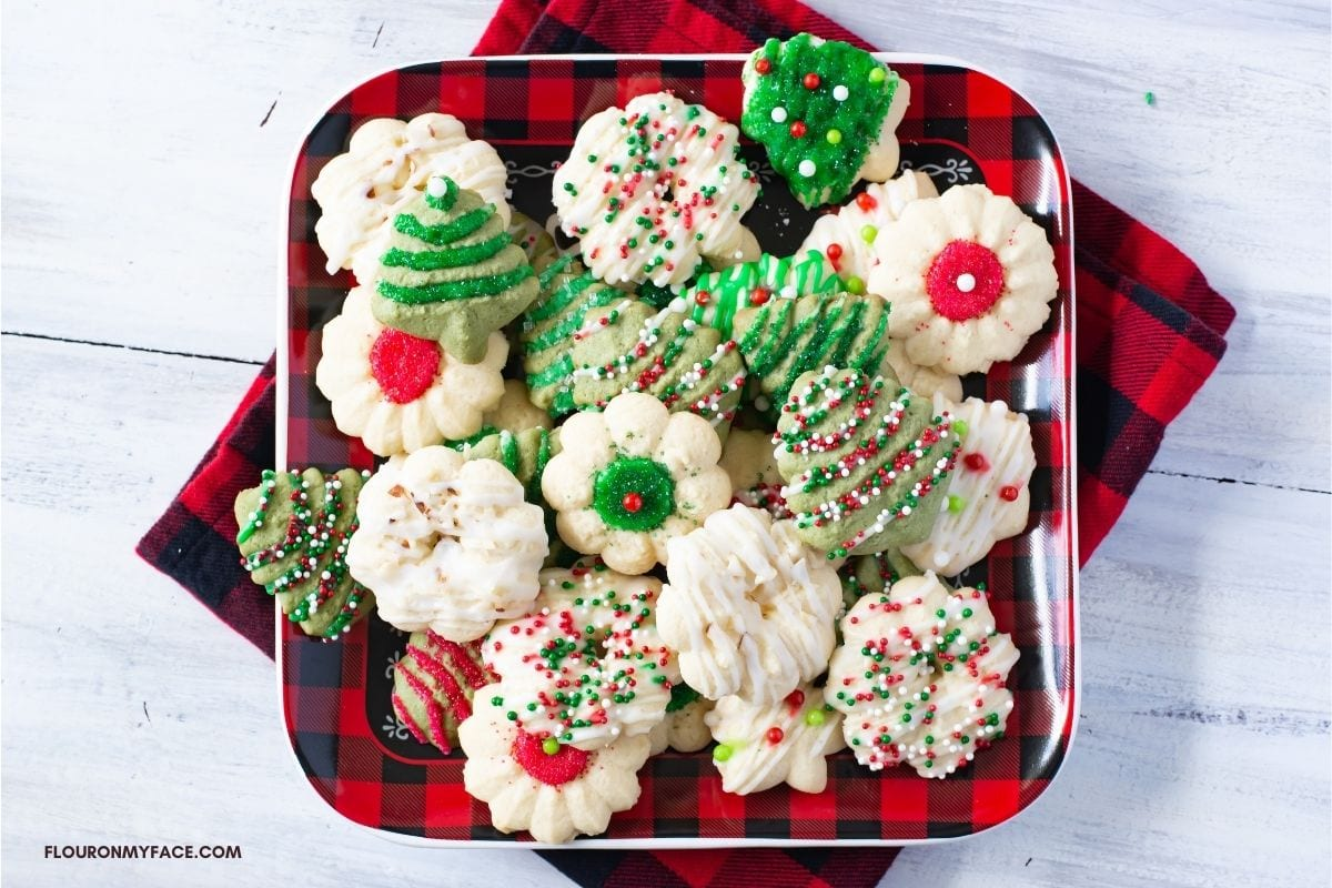 Holiday plate piled high with decorated Almond Spritz Cookies.