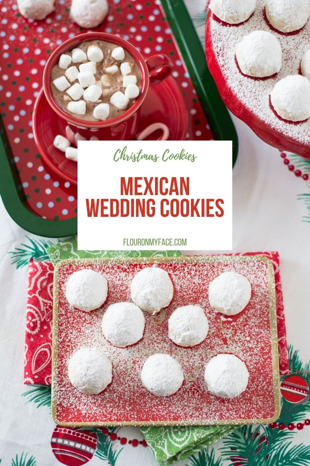 Overhead view of a platter of Mexican Wedding Cookies with a cup of hot cocoa.