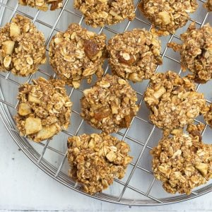 overhead closeup photo of Apple Cinnamon Breakfast Cookies as the cool on a cooling rack