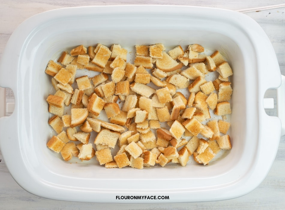 Toasted Bread cubes in a single layer in the crock pot