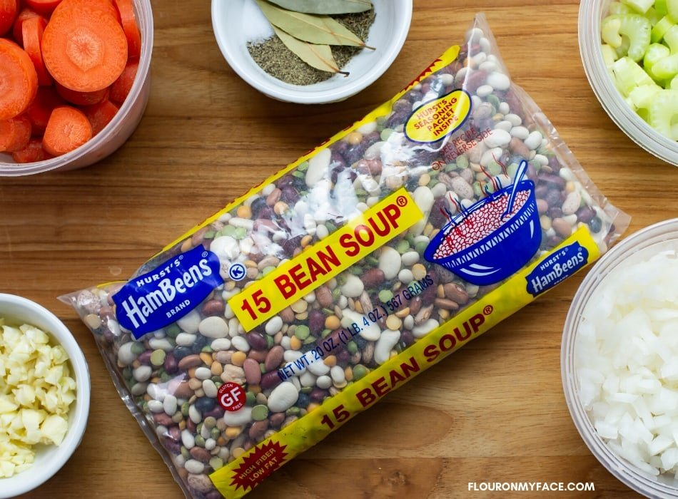 A bag of Hurst's HamBeens brand 15 Bean Soup with the ingredients to make a ground beef and bean soup.