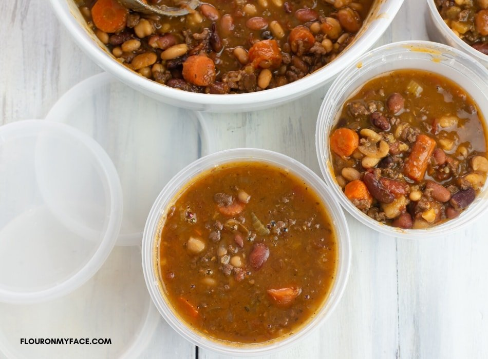 Freezer containers filled with leftover Instant Pot soup recipe for lunch or dinner later in the week.